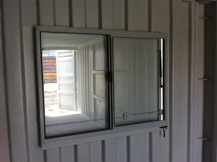 Transportable mobile workshop window inside