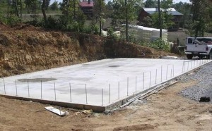 Image of shipping container construction with concrete slab foundation